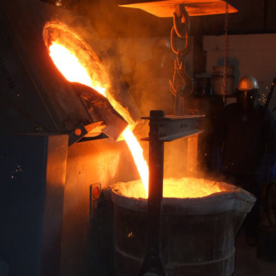 pouring metal from furnace to ladle in UK Cast Iron Foundry