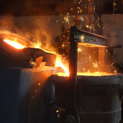 poring cast iron metal from furnace to ladle